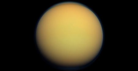 Saturn's moon Titan appears as a hazy ball from a distance. Credit: NASA/JPL-Caltech/Space Science Institute