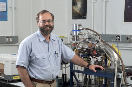 Scott Sandford next to a cryovacuum systems that helps reveal the chemistry that produces organic compounds of astrobiological interest. Credit: NASA Ames/Sandford