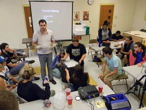 Figure 1.  Dr. Michel Nuevo teaches Choctaw youth how to build a comet at the Choctaw Summer camp held in Hartshorne, OK in July 2015.