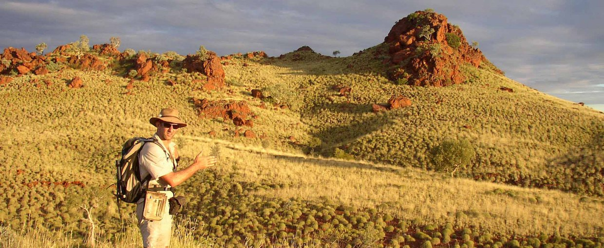 Martin Van Kranendonk, Director of the Australian Center for Astrobiology, doing field work in the Pilbara. Source: Eben Rose (via Astrobiology at NASA) Image credit: None