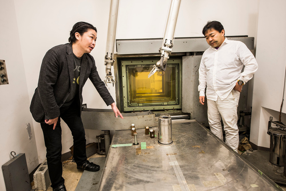 Masashi Aono, left, in the radiation room at the Tokyo Institute of Technology where his team produced formamine by exposing chemicals to radiation. Image credit: Nerissa Escanlar