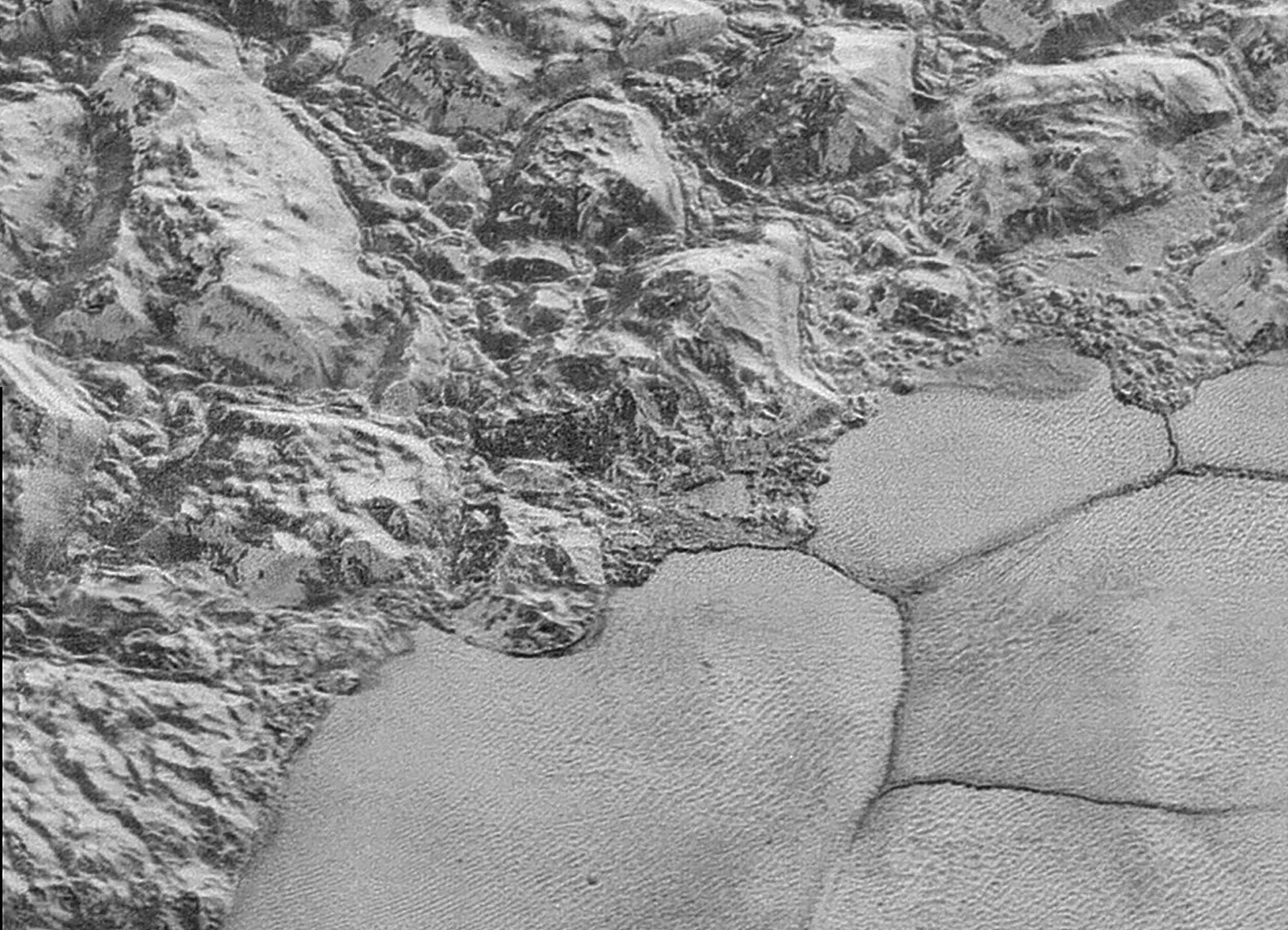 One of the surprises of the New Horizons mission was finding water ice mountains on Pluto, that quite possibly are floating on a subsurface ocean of liquid water. Image credit: NASA/JHUAPL/SWRI