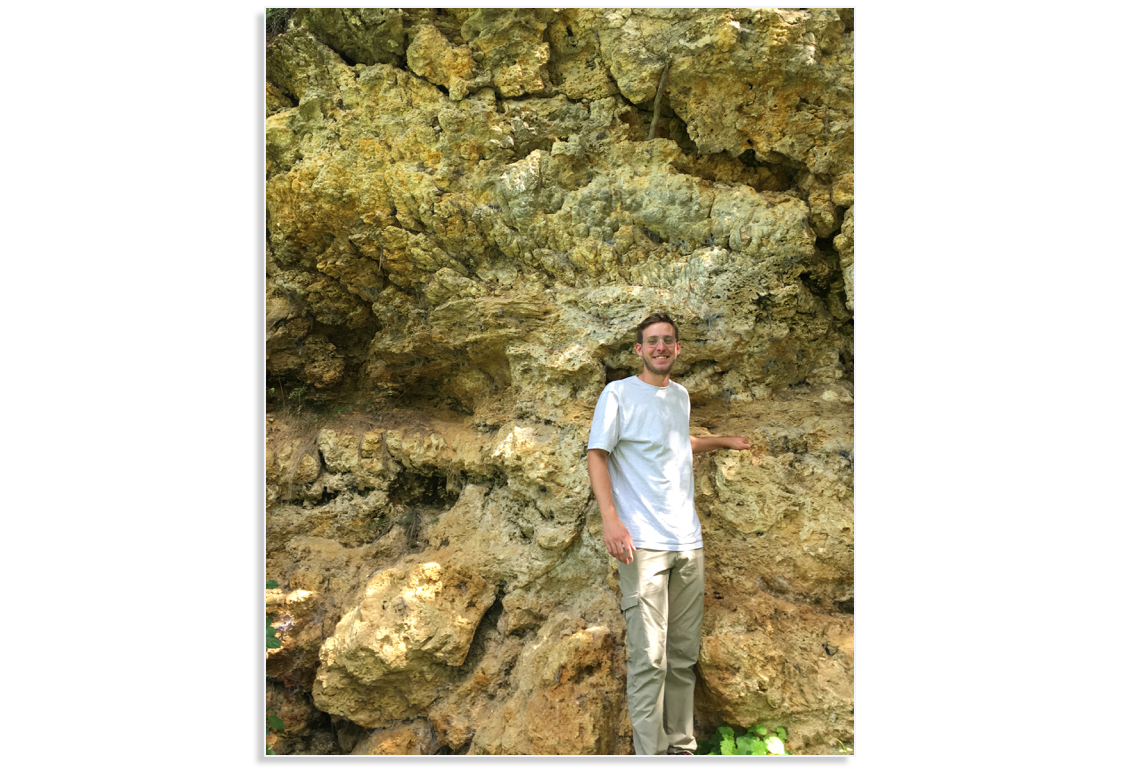 Chris Tino in front of a massive outcrop of fossil lacustrine microbialites in Nördlinger Ries crater, Germany. Source: UCR Image credit: None