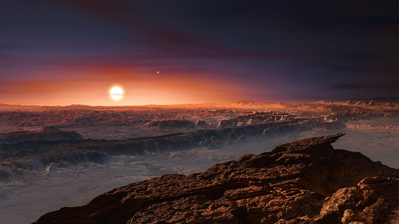 This artist's impression shows a view of the surface of the planet Proxima b orbiting the red dwarf star Proxima Centauri, the closest star to the solar system. Image credit: ESO/M. Kornmesser