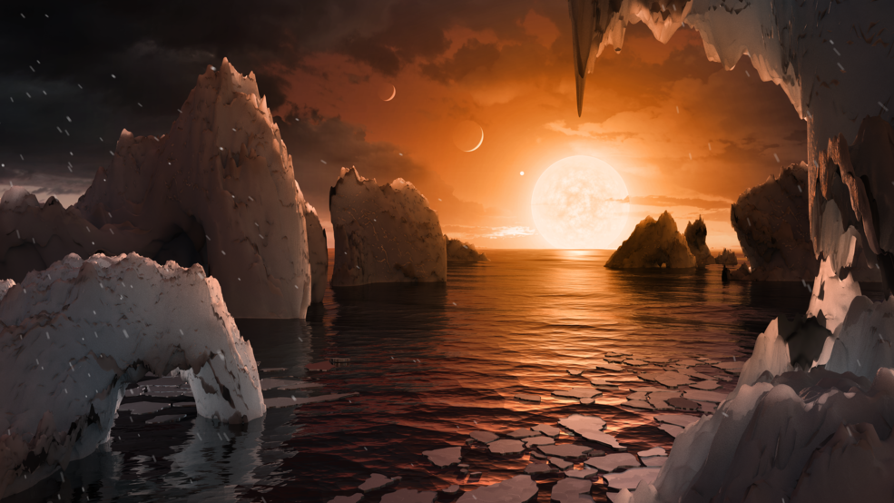 This illustration shows the possible surface of TRAPPIST-1f, one of the newly discovered planets in the TRAPPIST-1 system. Scientists using the Spitzer Space Telescope and ground-based telescopes have discovered that there are seven Earth-size planets in the system. Credits: NASA/JPL-Caltech Image credit: None
