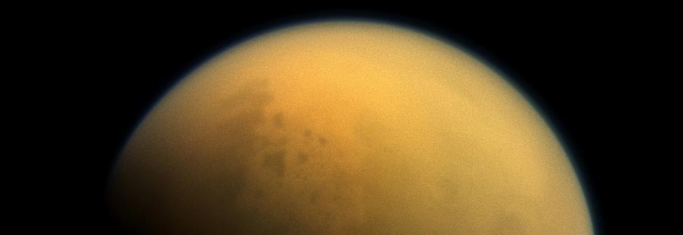 An image of Saturn's moon Titan, which is surrounded by a thick haze. Scientists speculate that a similar haze surrounding early Earth may have helped to make it habitable. Source: NASA. Image credit: None