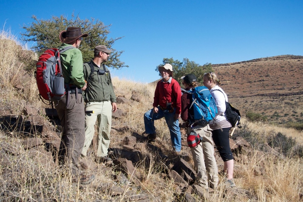 Participants in 2014 field excursion to collect fossils near the town of Kuruman in the Northern Cape Province of South Africa. From L to R: Clark Johnson,University of Wisconsin, Madison; Aaron Satkoski, University of Wisconsin, Madison; Nicolas Beukes, University of Johannesburg, South Africa; Breana Hashman,University of Wisconsin, Madison; and Kira Lorber, University of Cincinnati. Photo/Andrew Czaja Image credit: None