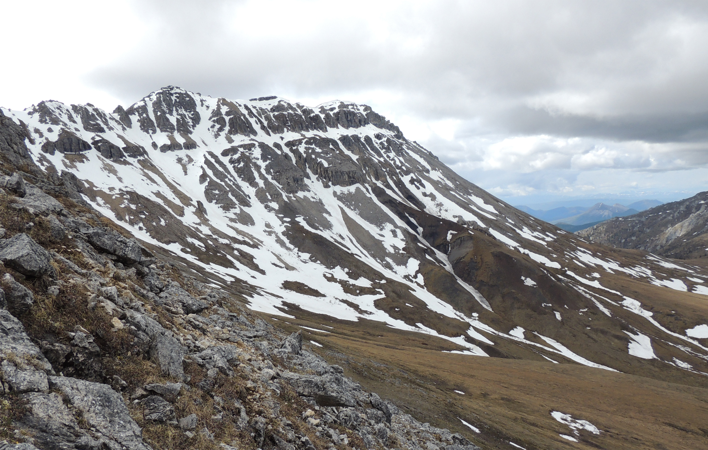 View of Mount Slipper looking towards the layers of rock that contain biomineralized fossils. Image credit: Phoebe A. Cohen