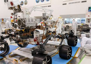 In a clean room at NASA's Jet Propulsion Laboratory in Southern California, engineers observed the first driving test for NASA's Mars 2020 Perseverance rover on Dec. 17, 2019.