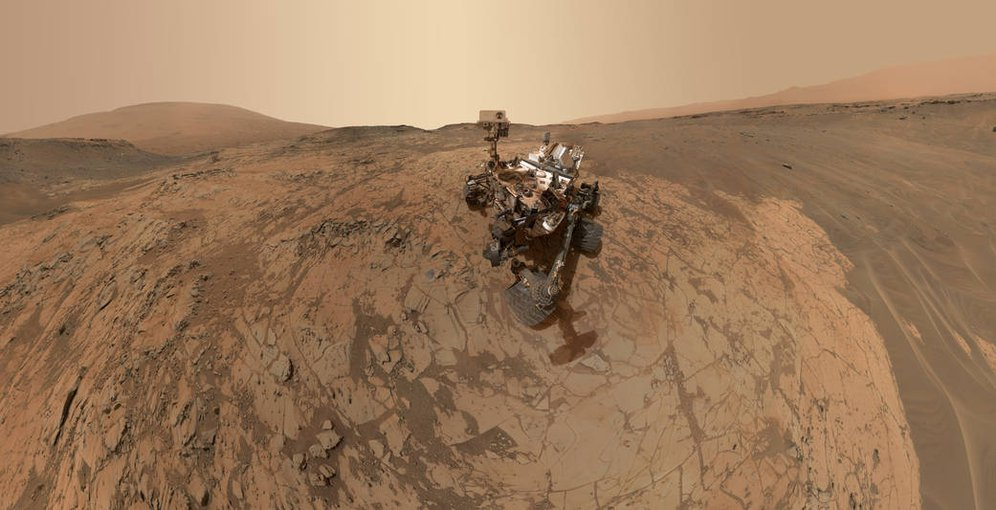 The Curiosity rover on Mars takes a selfie at a site named Mojave. Rock powdered by the rover drill system and then intensively heated rock and then heated to as much as 800 degrees centigrade produced positive findings for long-sought organics.