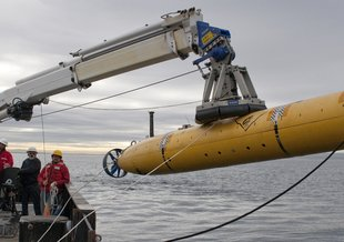The autonomous underwater vehicle (AUV) Gulper being deployed on the R/V Rachel Carson in 2012.