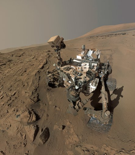 Mars Curiosity rover's one-year anniversary selfie.  The photo was actually composed of dozens of individual images taken between April and May 2014. Curiosity's mission is to find evidence of past or present habitable conditions on the surface of Mars.  Credit: NASA