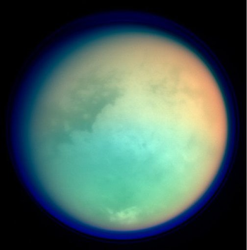 This image shows Titan in ultraviolet and infrared wavelengths. Red and green colors indicate where atmospheric methane is absorbing light, while the blue color shows the upper atmospheric haze.