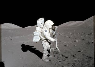 Scientist-astronaut Harrison H. Schmitt, Apollo 17 lunar module pilot, collects lunar rake samples at Station 1 during the mission's first spacewalk at the Taurus-Littrow landing site. Photo by commander Eugene A. Cernan.