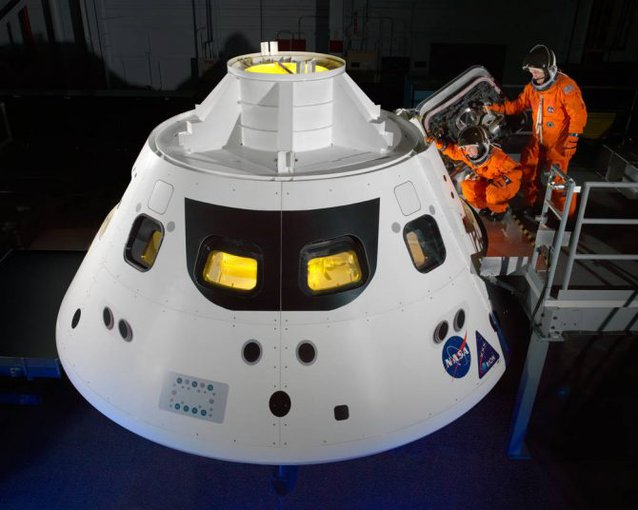 Astronauts go into an Orion capsule mock-up. The un-manned spacecraft is expected to be ready for launch in 2020.