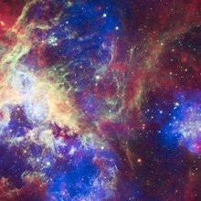 This composite of 30 Doradus, aka the Tarantula Nebula, contains data from Chandra (blue), Hubble (green), and Spitzer (red). Located in the Large Magellanic Cloud, the Tarantula Nebula is one of the largest star-forming regions close to the Milky Way.