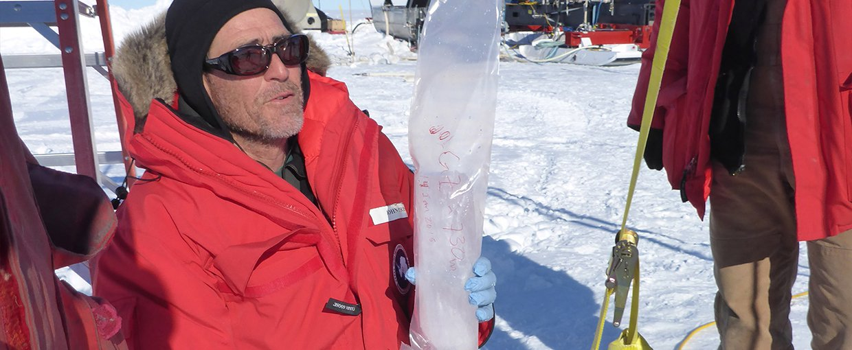 John Priscu (left) with an ice core extracted from a borehole into Lake Whillans.