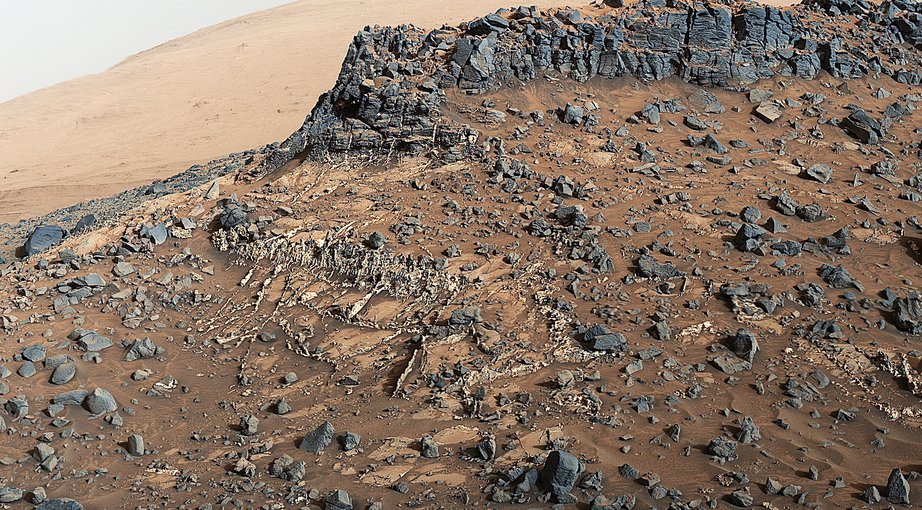 The Mast Camera (Mastcam) on NASA's Curiosity Mars rover captured a site with a network of prominent mineral veins below a cap rock ridge on lower Mount Sharp of Mars. Credits: NASA/JPL-Caltech/MSSS