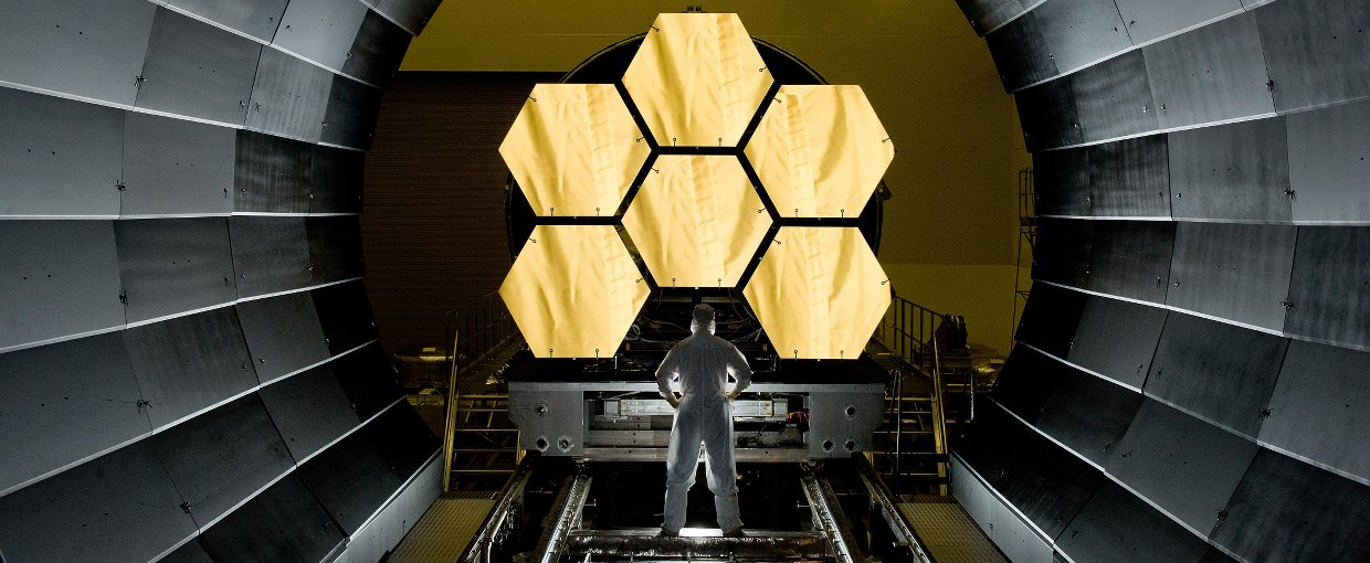NASA engineer Ernie Wright looks on as the first six flight ready James Webb Space Telescope primary mirror segments are prepped to begin final cryogenic testing at NASA's Marshall Space Flight Center. Credit: NASA/MSFC/David Higginbotham