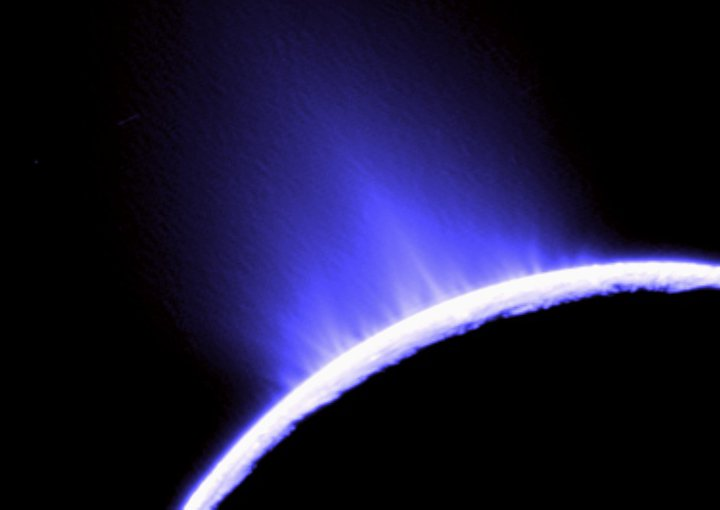This false color photo of water geysers spouting from Saturn's moon Enceladus was taken by NASA's Cassini. The geysers establish that there is a subsurface ocean beneath the icy crust of the moon.