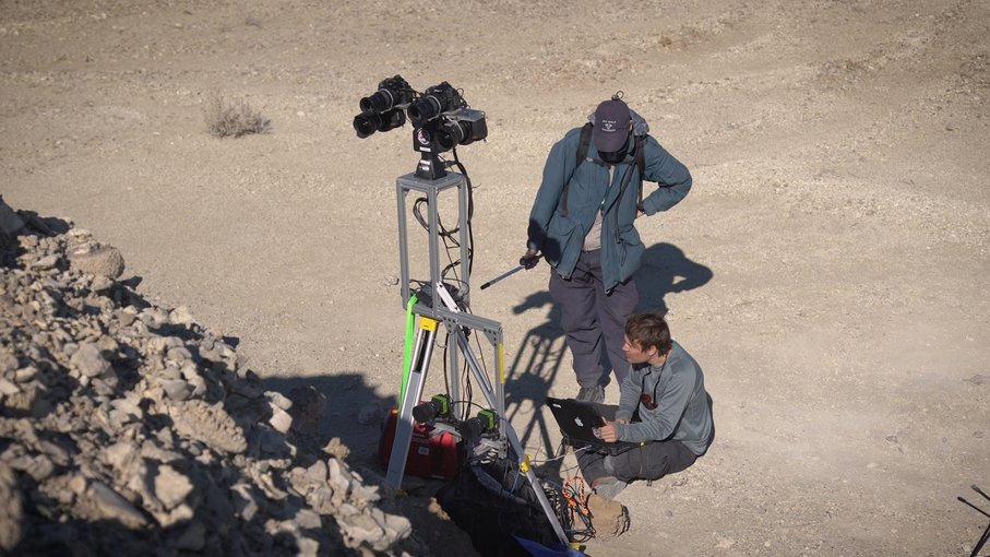 Two members of the field team set up cameras as part of the simulated rover operation. The images they provided were intended to stand in for what a rover's instruments might send back from Mars.