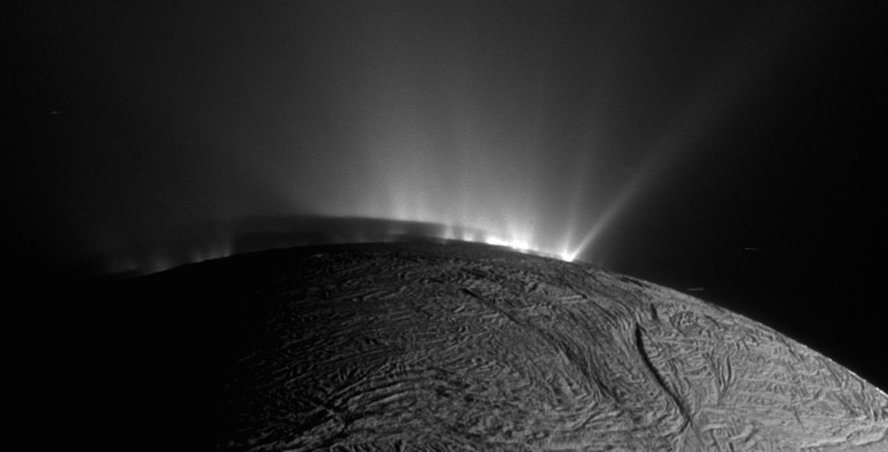 Plumes of water vapor spitting out from the inside of Saturn's moon Enceladus, as imaged by NASA's Cassini mission.