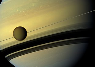 This Cassini image from 2012 shows Titan and its host planet Saturn.