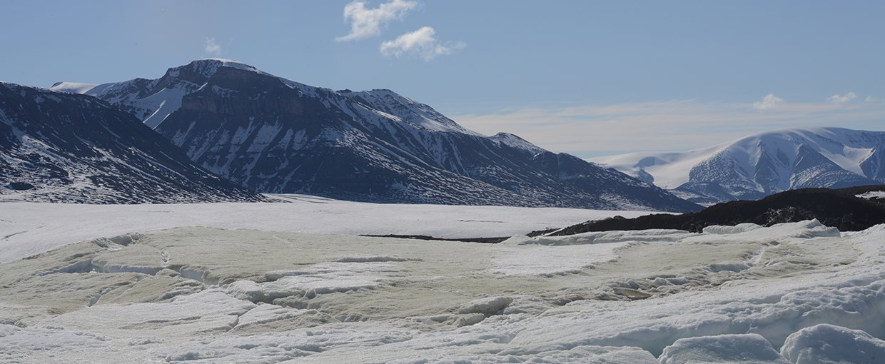 The sulidic outcrop on the toe of the Borup Fiord Pass glacier.  This image looks south with the sulfur icings spreading eastward.
