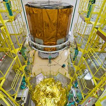 The Gaia star-mapper is lowered into position atop the Fregat upper stage for Soyuz.