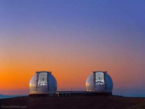 The sun sets on Mauna Kea as the twin Kecks prepare for observing.