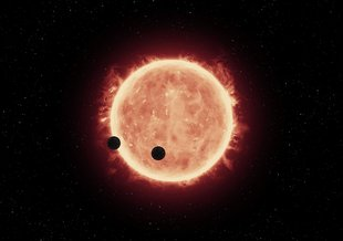 Spitzer Trains Its Eyes on Exoplanets. Credit: NASA