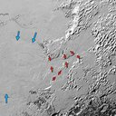Ice (probably frozen nitrogen) that appears to have accumulated on the uplands on the right side of this 390-mile (630-kilometer) wide image drains from Pluto's mountains onto Sputnik Planum through the 3- to 8- kilometer wide valleys (red arrows).