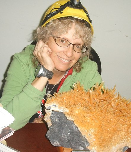 Penelope 'Penny' Boston poses with Naica Cave gypsum crystals.