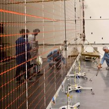 Technicians test the deployment of one of the three massive solar arrays that will power NASA's Juno spacecraft.