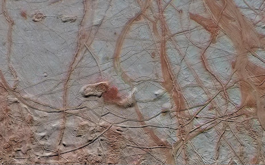 Enhanced-color view covering a 350 by 750 kilometer swath across the surface of Jupiter's moon Europa. The close-up combines high-resolution image data with lower resolution color data from observations made in 1998 by the Galileo spacecraft.