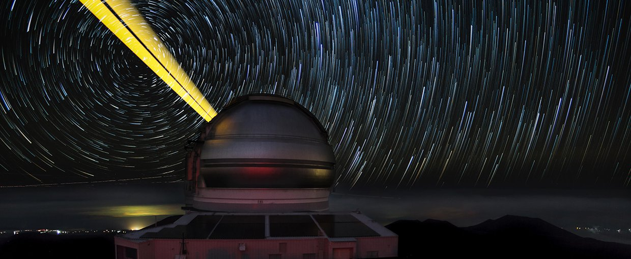 This image features the Gemini North telescope during laser guide star operations (LGS).