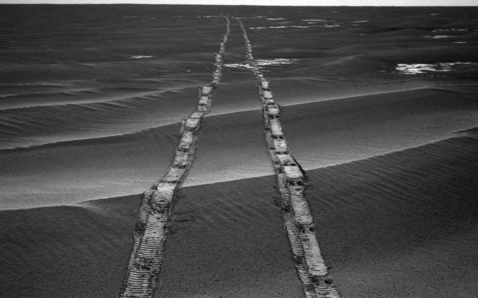 In this navigation camera raw image, NASA's Opportunity Rover looks back over its own tracks on Aug. 4, 2010.