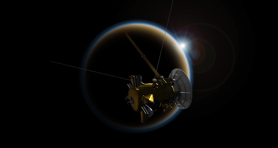 Artist's rendering of NASA's Cassini spacecraft observing a sunset through Titan's hazy atmosphere. Credit: NASA/JPL-Caltech