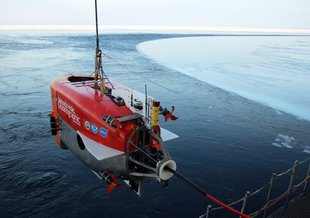 WHOI's Nereid Under Ice (NUI) submersible being lowered into the water.