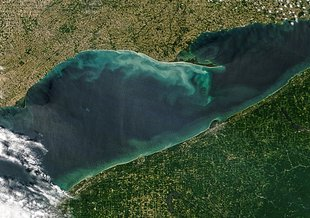 Seiches and whiting events and algae blooms are regular occurrences on Lake Erie. Each of these events can add swirls of color to the blue-green waters of the Great Lakes, as viewed from satellites.