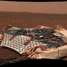 This image mosaic taken by the panoramic camera onboard the Mars Exploration Rover Spirit shows the rover's landing site, the Columbia Memorial Station, at Gusev Crater, Mars.