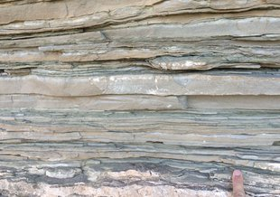 Close-up view of layered sedimentary rocks representative of those used in this study. Each layer records a snapshot of the Earth system over millions to billions of years.