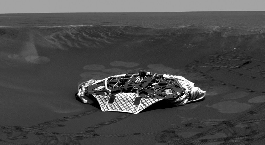 This image mosaic shows a panoramic view of the crater where Opportunity made its its dramatic arrival in late January 2004.
