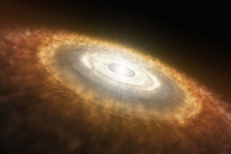 Artist's illustration of a protoplanetary disk. The chemistry of a protoplanetary disk determines what molecules are incorporated into a newly forming planet's atmosphere.