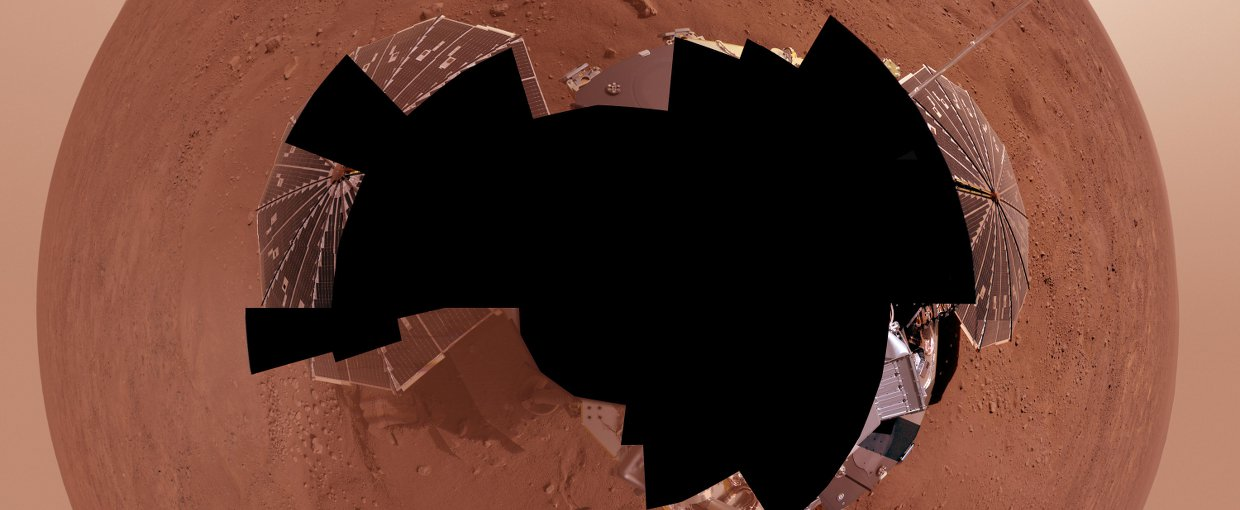 NASA's Phoenix Mars Lander views its surroundings in the Red Planet's northernmost region. The full-circle panorama in approximately true color shows the polygonal patterning of ground at the landing area, similar to patterns in permafrost areas on Earth.