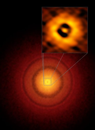 ALMA images of details in the planet-forming disk around a nearby sun-like star, TW Hydrae, including a gap at the same distance from the star as the Earth is from the Sun, suggesting a planet might be forming.