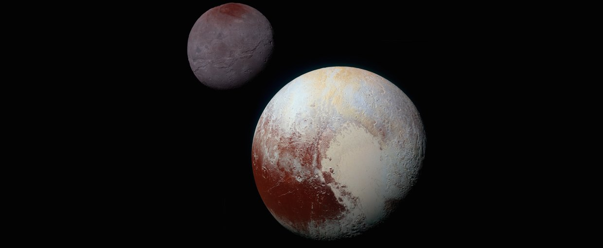 This composite of enhanced color images of Pluto (lower right) and Charon (upper left), was taken by NASA's New Horizons spacecraft as it passed through the Pluto system on July 14, 2015. This image highlights the striking differences between them.