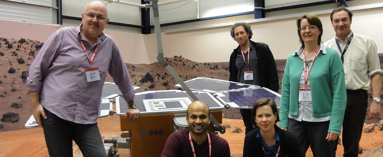 Manish Patel and the NOMAD science team with a prototype of the ExoMars rover in the Mars Yard at ESTEC in the Netherlands.