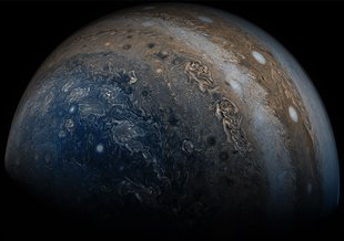 NASA's Juno spacecraft was racing away from Jupiter following its seventh close pass of the planet when JunoCam snapped this image on May 19, 2017, from about 29,100 miles (46,900 kilometers) above the cloud tops.