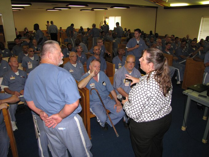 Dr. Jamie Foster of the University of Florida answers questions during a break in her lecture at a prison in Florida.